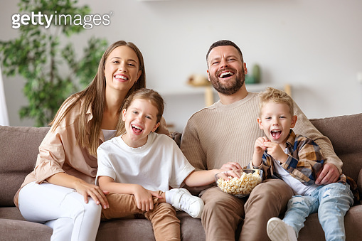Happy family watching comedy together