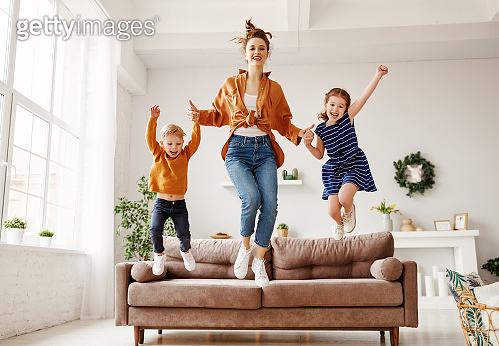 Playful woman and kids having fun at home