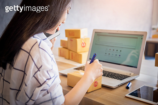 Portrait of Young asian working online shopping with laptop computer at home. Selling online and delivery concept