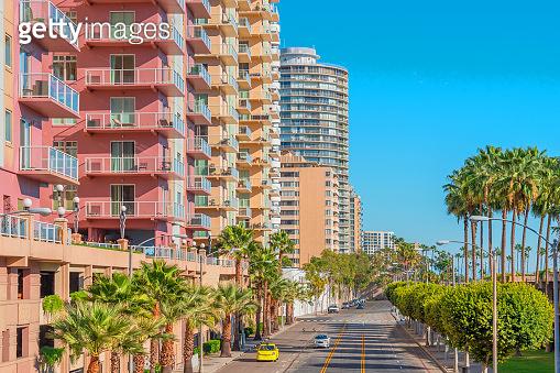 High rise  downtown buildings line road  in Long Beach, California (P)