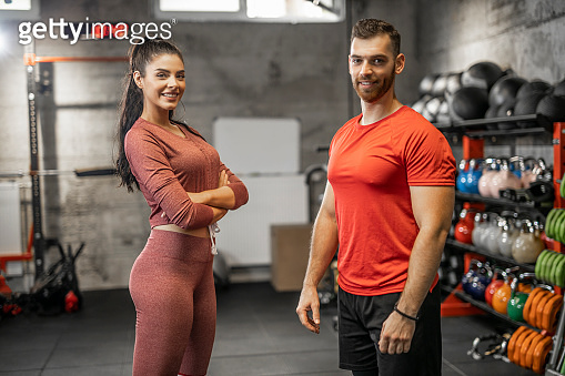 Portrait of two fitness instructors in the gym