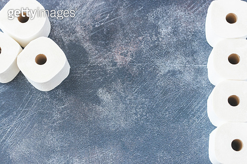 Soft white toilet paper roll on dark background
