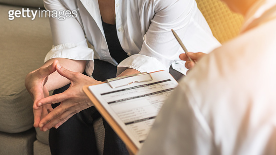 Woman patient with doctor or psychiatrist consulting and diagnostic examining on obstetric - gynecological female illness, or mental health in medical clinic or hospital healthcare service center