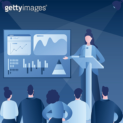 Business presentation or conference. Successful businesswoman performs on rostrum in front of an audience.