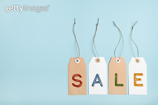 Set of tags with word SALE on a blue background. Seasonal discounts in stores