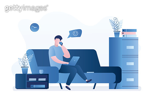 Handsome businessman or freelancer sitting on sofa. Workplace at home or modern coworking interior.