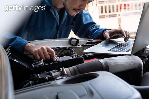 Professional mechanic providing car repair service
