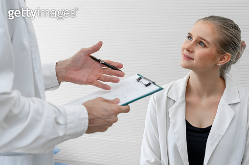 Doctor in professional uniform examining patient at hospital