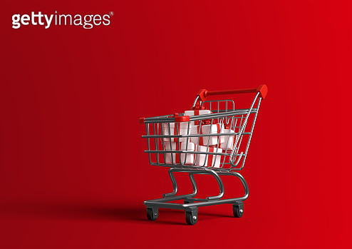 Shopping cart full of gift box red ribbon on red background