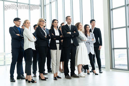 Successful business people standing together