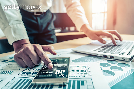 Businessman analyze data of stock market research.