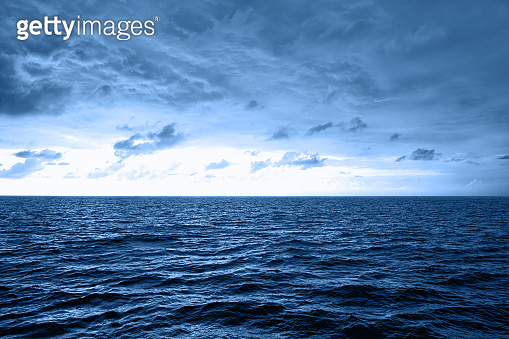 Beautiful blue waves with lot of sea. Trendy color concept of year, classic blue background. Modern stylish, copy space.