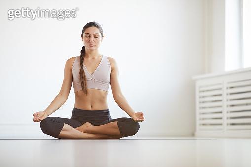 Healthy woman meditating