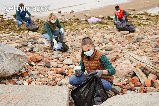 Group of volunteers picking up the rubbish
