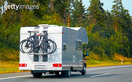 Caravan with bicycles on highway at Switzerland