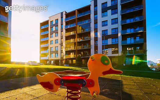 Apartment residential house facade architecture and children playground sun light reflex