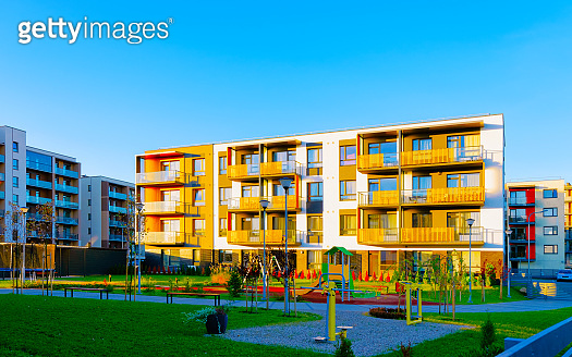 Apartment residential house facade architecture and kids playground reflex
