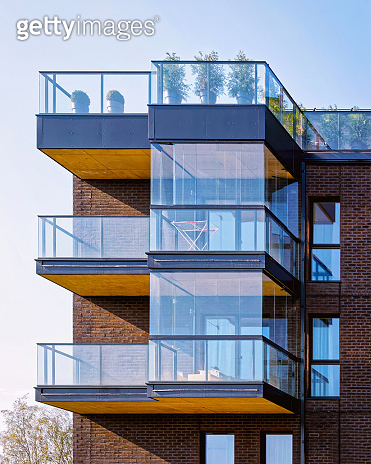 Fragment of Modern architecture of apartment building reflex