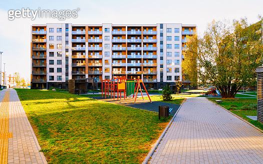 Apartment residential house facade architecture with kids playground reflex