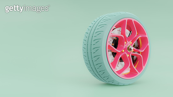 Pink alloy wheel with blue tires.