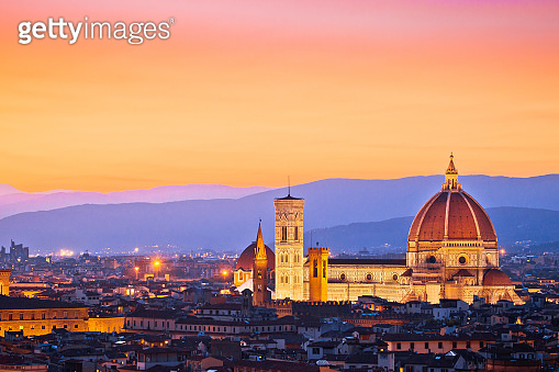 Colorful Florence rooftops and Duomo view at sunset
