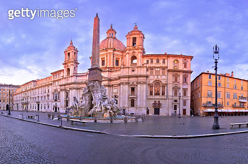 Rome. Empty Piazza Navona square fountains and church view in Rome