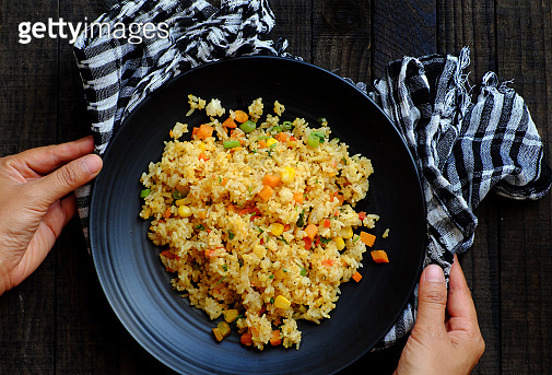 Top view Vietnamese food, fried rice with colorful vegetables for vegetarian meal