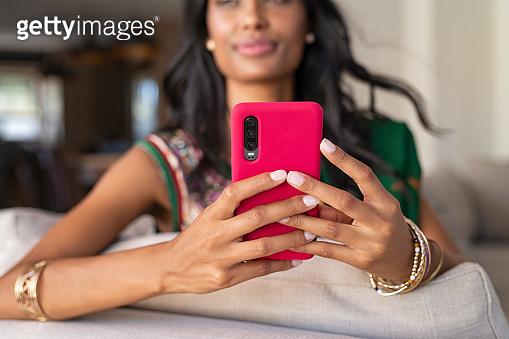 Indian girl in ethnic wear using phone