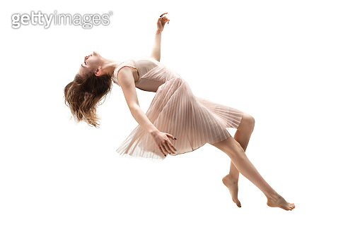 Mid-air beauty. Full length studio shot of attractive young woman hovering in air and keeping eyes closed