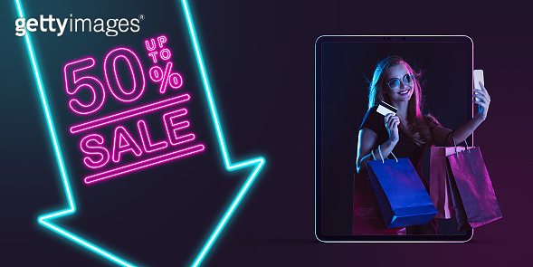Beautiful woman inviting for shopping right from device screen, black friday, sales concept. Flyer with copyspace