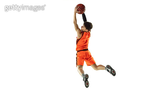 Young basketball player training isolated on white studio background