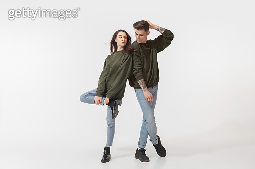 Trendy fashionable couple isolated on white studio background