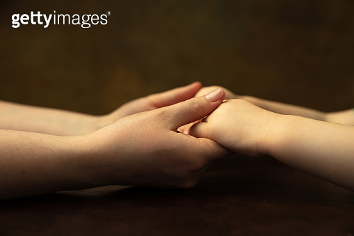 Close up of female and kid's hands doing things together, family, home concept