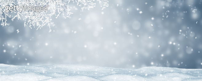 abstract winter landscape idyll with blurred background, deep snow and snowflakes for advent season holiday concept with advertising space, empty silver christmas background