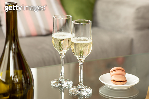 Glasses of sparkling champagne, close up. Warm colored. Celebration event, holidays, drinks concept