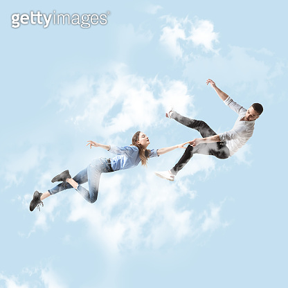 Mid-air beauty. Full length studio shot of attractive young woman and man hovering in air and keeping eyes closed