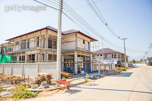 New residential house contemporary style building in progress at construction site