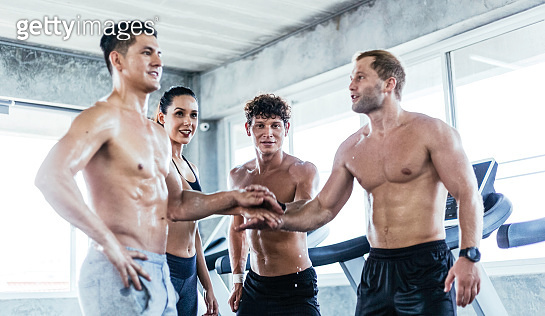 Group of Caucasian athletic man and woman put hand together show team spirit, unity and support to workout exercise. Motivation people do fitness at gym. healthy and lifestyle preventing virus disease
