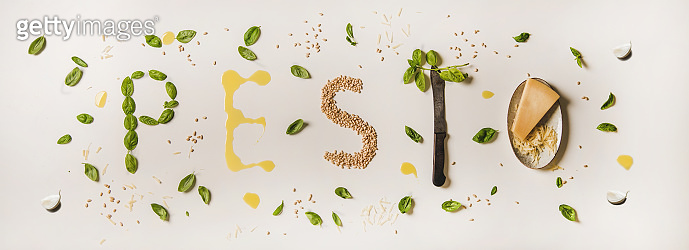 Cooking ingredients forming word pesto over white plain background