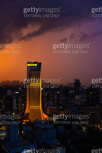 Building skyscraper maybank at sunset rain clouds. Gorgeous views of the landscapes of Kuala Lumpur