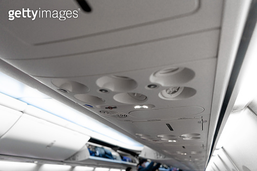 Control panel for ventilation and lighting in a passenger seat in an airplane
