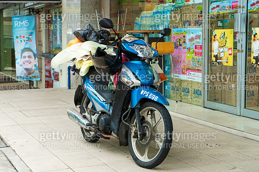 Bike loaded with things. Transport in Asia. Transportation of goods on a bike.