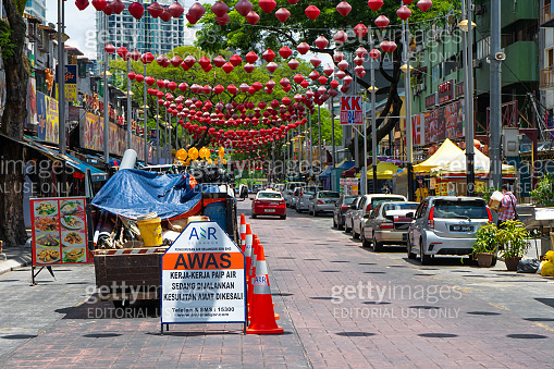 Jalan Alor food street in Kuala Lumpur. The utility vehicle truck displayed warning signs.
