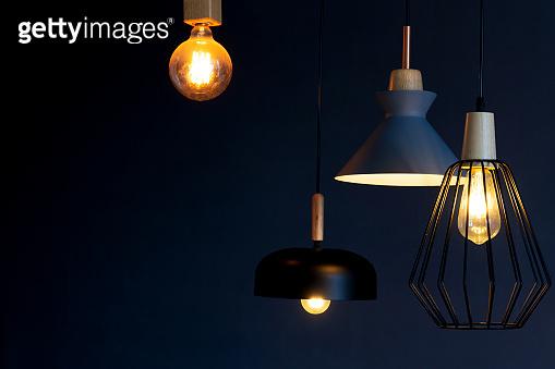 Interior decoration of stylish housing. Loft style incandescent lamp. Modern style home design
