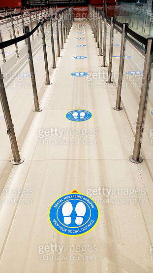 Airport during the coronavirus pandemic. There are markings on the floor for social distance in line