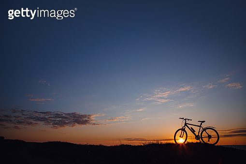 silhouette of a bicycle on the sunset sky