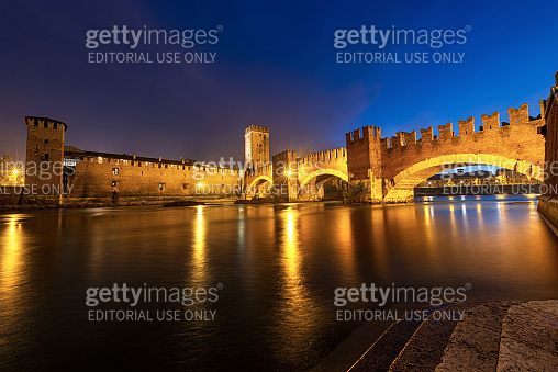 Castelvecchio and Scaligero Bridge at night in Verona - Medieval Old Castle