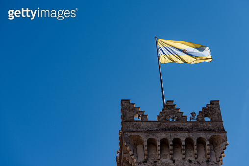 Torre Civica - Medieval civic tower with the flag of Trento Italy