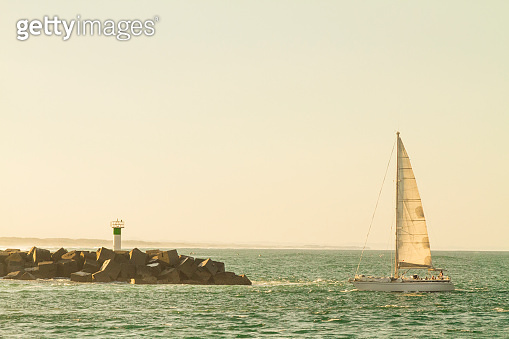 The Spit Lighthouse and a sailboat, Gold Coast, Queensland