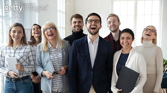 Diverse emotional business people feeling overjoyed.